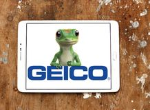 GEICO Insurance Company logo. Logo of GEICO Insurance Company on samsung tablet on wooden background. GEICO, Government Employees Insurance Company, is an Royalty Free Stock Photos