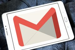 Gmail logo. Logo of Gmail on samsung tablet. Gmail is a free, advertising-supported email service developed by Google. Users can access Gmail on the web and Stock Photos