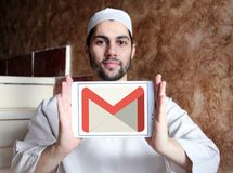 Gmail logo. Logo of Gmail on samsung tablet holded by arab muslim man. Gmail is a free, advertising-supported email service developed by Google. Users can access Royalty Free Stock Photography