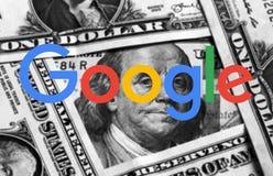 Google logo. Logo of google company on dollar bills money background royalty free stock photography