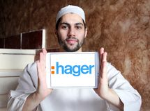 Hager Group logo. Logo of Hager Group on samsung tablet holded by arab muslim man. Hager Group is a leading provider of solutions and services for electrical Stock Photo