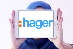 Hager Group logo. Logo of Hager Group on samsung tablet holded by arab muslim woman. Hager Group is a leading provider of solutions and services for electrical Stock Photography