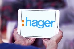 Hager Group logo. Logo of Hager Group on samsung tablet. Hager Group is a leading provider of solutions and services for electrical installations in residential Stock Photography