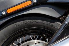 Logo of Harley Davidson on a custom tire of Harley Davidson bike. Kyiv, Ukraine, - April 20, 2018: Logo of Harley Davidson on a custom tire of Harley Davidson stock photo