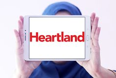 Heartland payment systems logo. Logo of Heartland payment company on samsung tablet holded by arab muslim woman. Heartland offers credit and debit card payment Stock Images
