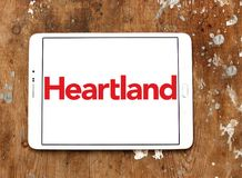 Heartland payment systems logo. Logo of Heartland payment company on samsung tablet. Heartland offers credit and debit card payment processing for small to large Royalty Free Stock Images