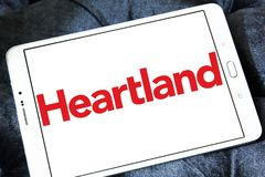 Heartland payment systems logo. Logo of Heartland payment company on samsung tablet. Heartland offers credit and debit card payment processing for small to large Royalty Free Stock Photography