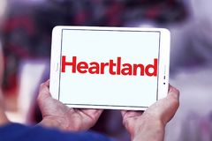 Heartland payment systems logo. Logo of Heartland payment company on samsung tablet. Heartland offers credit and debit card payment processing for small to large Royalty Free Stock Photo