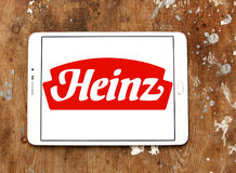 Heinz logo. Logo of heinz company on samsung tablet on wooden background royalty free stock images