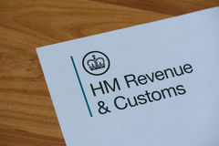 The logo of Her Majestys Revneue and Customs. London, United Kingdom, June 28, 2017:  The logo of Her Majestys Revneue and Customs on a piece of paper. HMRC is a Royalty Free Stock Image
