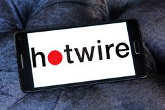 Hotwire company logo. Logo of Hotwire company on samsung mobile. Hotwire is a travel website that can be used to book airline tickets, hotel rooms, rental cars Royalty Free Stock Images