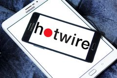 Hotwire company logo. Logo of Hotwire company on samsung mobile. Hotwire is a travel website that can be used to book airline tickets, hotel rooms, rental cars Stock Photos