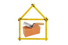 Logo for house and construction company. With brick and folding rule Stock Photography