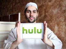 Hulu company logo. Logo of Hulu on samsung tablet holded by arab muslim man. Hulu is an American subscription video on demand service owned by Hulu LLC, a joint Royalty Free Stock Photo