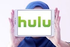 Hulu company logo. Logo of Hulu on samsung tablet holded by arab muslim woman. Hulu is an American subscription video on demand service owned by Hulu LLC, a Stock Image