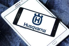 Husqvarna company logo. Logo of Husqvarna company on samsung mobile. Husqvarna is a manufacturer of outdoor power products including chainsaws, trimmers Stock Photos