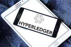 Hyperledger logo. Logo of Hyperledger on samsung mobile. Hyperledger is an umbrella project of open source blockchains and related tools started in December 2015 Royalty Free Stock Photo