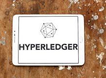 Hyperledger logo. Logo of Hyperledger on samsung tablet on wooden background. Hyperledger is an umbrella project of open source blockchains and related tools Stock Photo