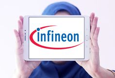 Infineon Technologies company logo. Logo of Infineon Technologies company on samsung tablet holded by arab muslim woman. Infineon Technologies AG is a German Royalty Free Stock Images