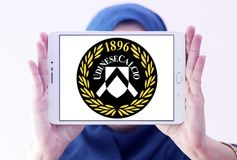 Udinese Calcio football club logo. Logo of italian Udinese Calcio football club on samsung tablet holded by arab muslim woman Stock Photos