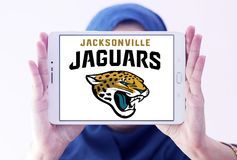 Jacksonville Jaguars american football team logo. Logo of Jacksonville Jaguars american football team on samsung tablet holded by arab muslim woman. The Stock Images