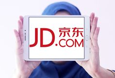 JD.com logo. Logo of JD.com on samsung tablet holded by arab muslm woman. JD.com is a Chinese e-commerce company.  It is one of the two largest B2C online Royalty Free Stock Photo