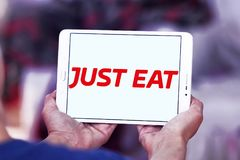 Just Eat food delivery company logo. Logo of Just Eat company on samsung tablet. just Eat plc is an online food order and delivery service royalty free stock photo