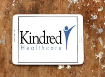 Kindred Healthcare logo. Logo of Kindred Healthcare on samsung tablet. Kindred Healthcare Incorporated is a healthcare services company that operates hospitals Stock Photos