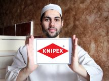 Knipex company logo. Logo of Knipex company on samsung tablet holded by arab muslim man. Knipex is a German manufacturer of pliers for professional use Stock Images