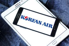 Korean Air logo. Logo of Korean Air on samsung mobile. Korean Air, is the largest airline and flag carrier of South Korea royalty free stock photos