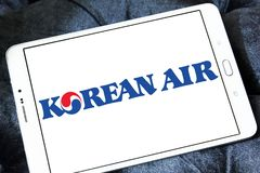 Korean Air logo. Logo of Korean Air on samsung tablet. Korean Air, is the largest airline and flag carrier of South Korea royalty free stock photography
