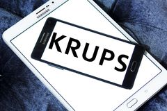 Krups Company logo. Logo of Krups Company on samsung mobile. Krups is a German kitchen appliance manufacturer. It is part of the Groupe SEB stock photography