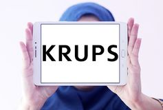 Krups Company logo. Logo of Krups Company on samsung tablet holded by arab muslim woman. Krups is a German kitchen appliance manufacturer. It is part of the stock photos