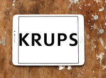 Krups Company logo. Logo of Krups Company on samsung tablet. Krups is a German kitchen appliance manufacturer. It is part of the Groupe SEB stock photography