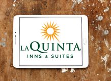 La Quinta Inns and Suites logo. Logo of La Quinta Inns and Suites on samsung tablet. La Quinta is a chain of limited service hotels stock photos
