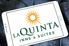La Quinta Inns and Suites logo. Logo of La Quinta Inns and Suites on samsung tablet. La Quinta is a chain of limited service hotels stock image