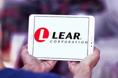 Lear Corporation logo. Logo of Lear Corporation company on samsung tablet. Lear Corporation headquartered in Southfield, Michigan, United States of America, is a royalty free stock image