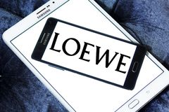 LOEWE fashion brand logo. Logo of LOEWE fashion brand on samsung mobile. LOEWE is a Spanish luxury fashion house based in Madrid and owned by the LVMH Group stock photos