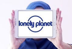 Lonely Planet logo. Logo of Lonely Planet on samsung tablet holded by arab muslim woman. Lonely Planet is the largest travel guide book publisher in the world stock photos