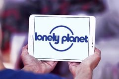 Lonely Planet logo. Logo of Lonely Planet on samsung tablet. Lonely Planet is the largest travel guide book publisher in the world royalty free stock photo