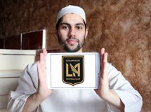 Los Angeles FC Soccer Club logo. Logo of Los Angeles FC Soccer Club on samsung tablet holded by arab muslim man. Los Angeles Football Club is an American Royalty Free Stock Photo