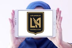 Los Angeles FC Soccer Club logo. Logo of Los Angeles FC Soccer Club on samsung tablet holded by arab muslim woman. Los Angeles Football Club is an American Royalty Free Stock Images