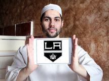 Los Angeles Kings ice hockey team logo. Logo of Los Angeles Kings ice hockey team on samsung tablet holded by arab muslim man. The Los Angeles Kings are a Stock Photo