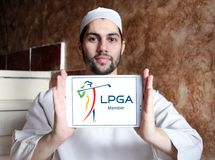LPGA logo. Logo of LPGA on samsung tablet holded by arab muslim man. The Ladies Professional Golf Association LPGA is an American organization for female Royalty Free Stock Photography