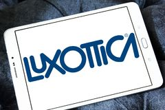 Luxottica eyewear company logo. Logo of Luxottica eyewear company on samsung tablet . Luxottica Group S.p.A. is the world`s largest eyewear company Royalty Free Stock Photo