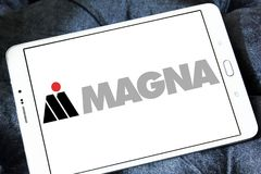Magna automotive supplier logo. Logo of Magna automotive supplier on samsung tablet. Magna International Inc. is a Canadian global automotive supplier stock image