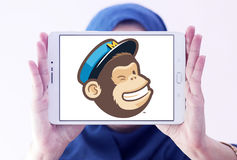 MailChimp company logo. Logo of MailChimp on samsung tablet holded by arab muslim woman. MailChimp is a marketing automation platform and an email marketing Stock Photo