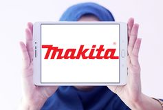 Makita Corporation logo. Logo of Makita Corporation on samsung tablet holded by arab muslim woman. Makita is a manufacturer of power tools Royalty Free Stock Photography