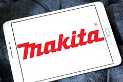 Makita Corporation logo. Logo of Makita Corporation on samsung tablet. Makita is a manufacturer of power tools Royalty Free Stock Images