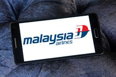 Malaysia Airlines logo. Logo of Malaysia Airlines on samsung mobile. Malaysia Airlines is the flag carrier of Malaysia and a member of the oneworld airline Royalty Free Stock Photos